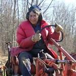 Liz Henderson drives a tractor
