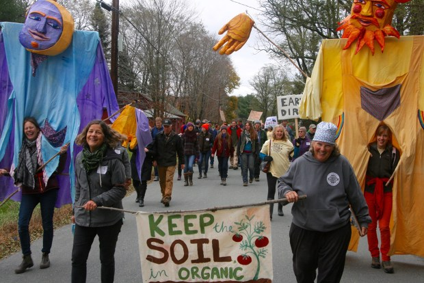 Enid Wonnacott marches at an early rally for Keeping the Soil in USDA organic.