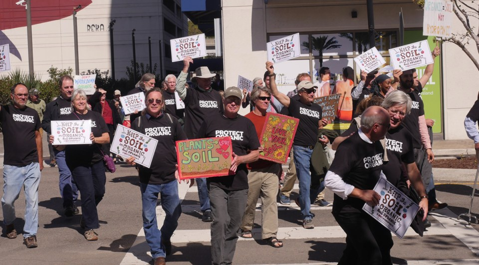 farmers rally to protest the usda at a national organic standards board meeting in the fall of 2017 in Jacksonville Florida