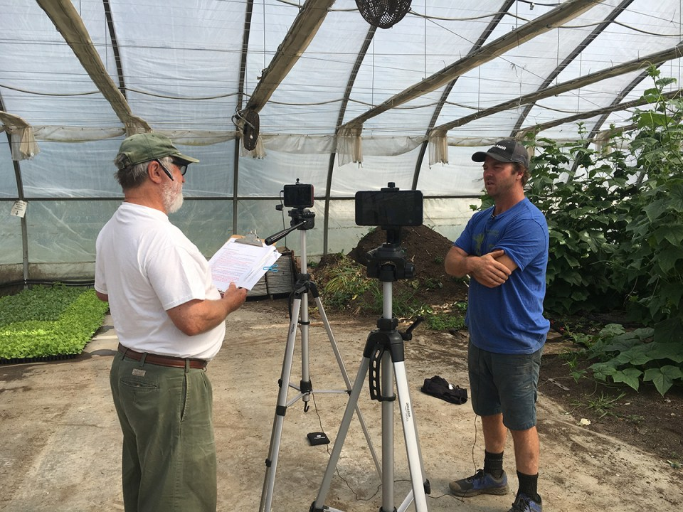 Dave Miskell interviews Pete Johnson for the Real Organic Project in a hoop house filled with vining squash