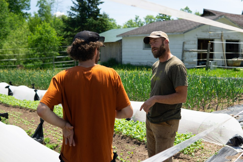 Jonathan Parsons talks farming with Ralf Carestia at UProoted Farm Michigan