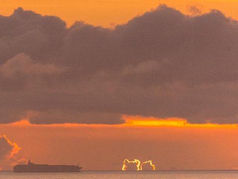 Ship and sky at dawn