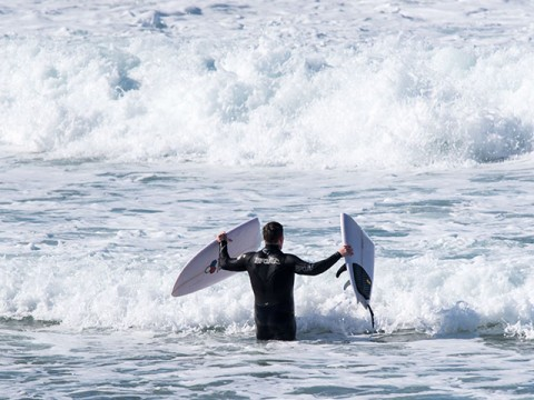 surfer with broken board