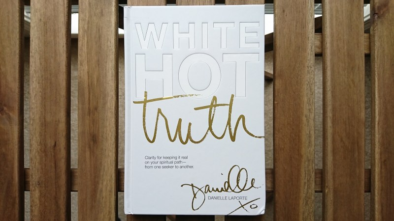 photo of the book White Hot Truth by Danielle LaPorte with an all white cover and the first 2 words of the title embossed and the 3rd word of the title in gold.