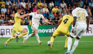 Real Madrid's Welsh forward Gareth Bale (2L) scores a goal during the Spanish League match Villarreal CF against Real Madrid at La Ceramica stadium in Vila-real on September 1, 2019. (Photo credit by Josep LAGO / AFP) (Photo credit should read JOSEP LAGO / AFP / Getty Images)