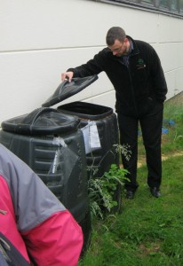 Inspecting the compost maturation bins at Charleston Academy