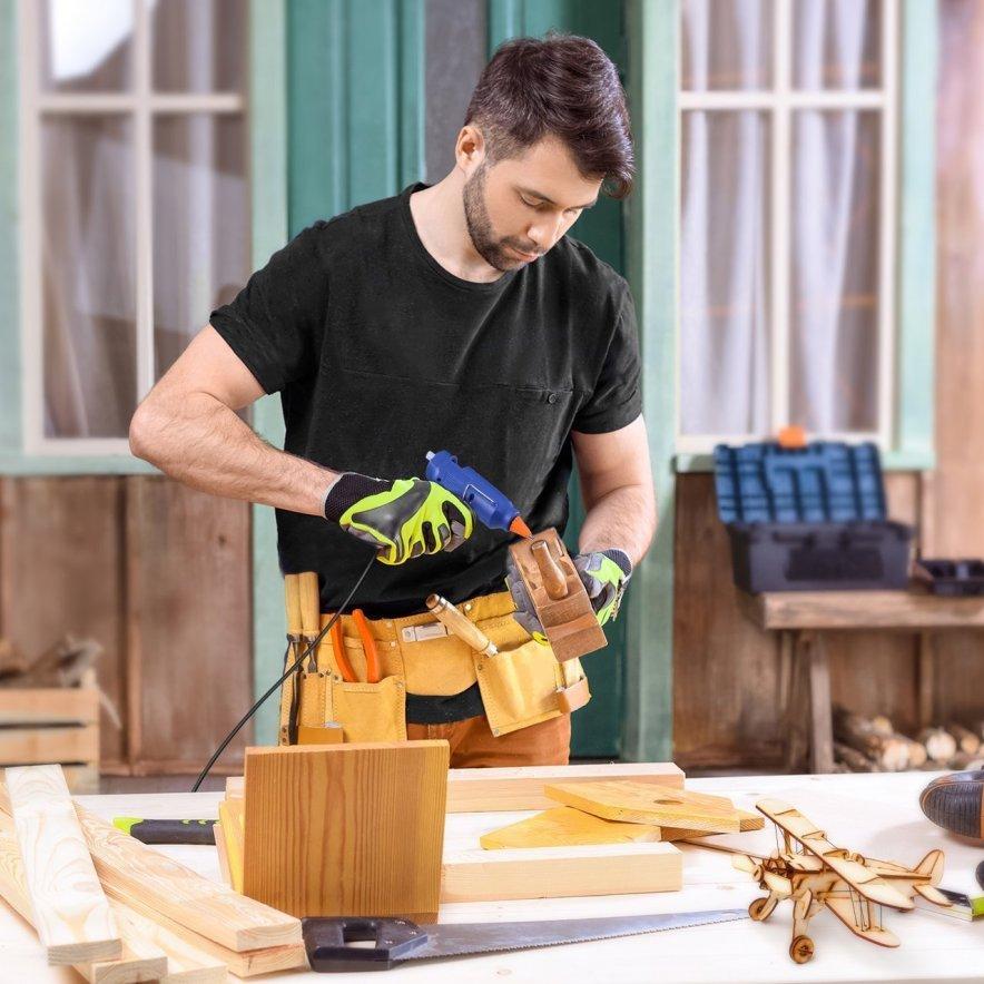 man using a hot glue gun