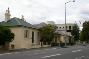 The four houses and Aurora Building behind