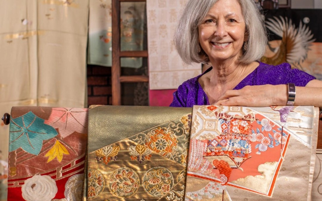 Prof. Rebecca Copeland, in her home with her collection of kimonos