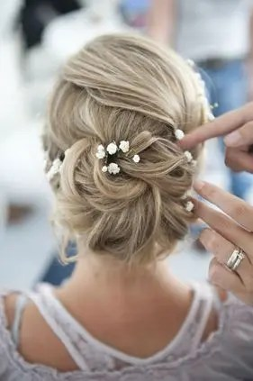 2015 Wedding Trends - Flowers pinned into bridal hairstyle from Rebecca Loves Weddings www.rebeccaanderton.co.uk