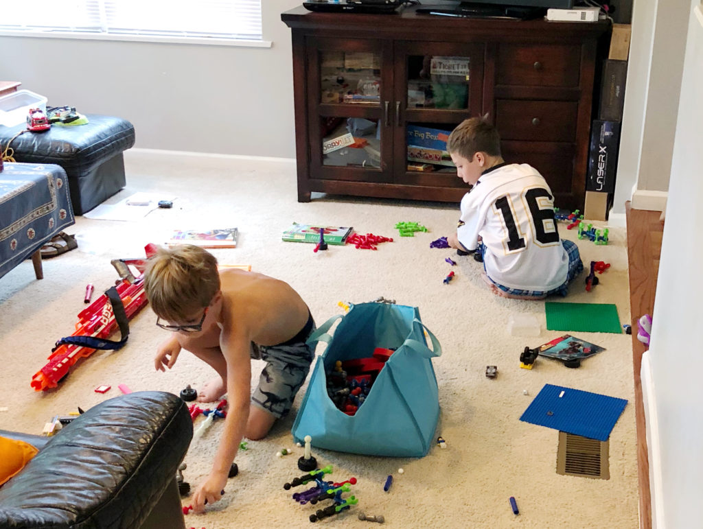 two boys, ages 10 & 7, play on the living room floor which is strewn with colorful toys, including Legos, Nerf guns and other building sets. They've been playing peacefully for hours today, day one back on their medication.