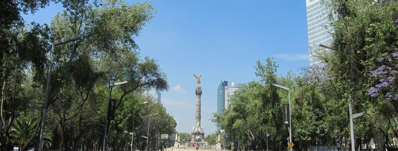 every Sunday Paseo de la Reforma closed to motor vehicles. People ride their bikes on the multi-lane road.