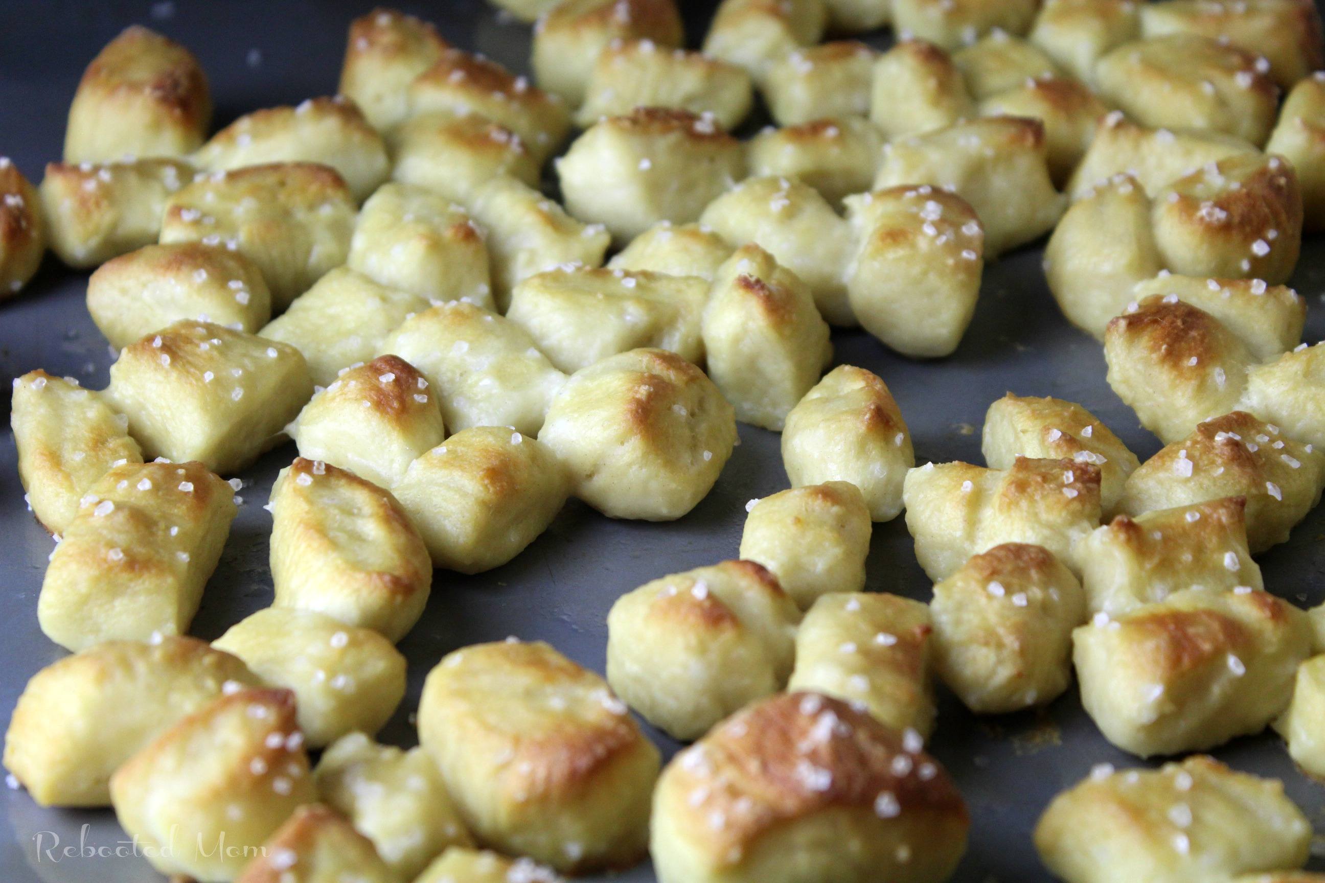 These yummy pretzel bites are simple to whip up and delicious when served as an appetizer or snack. You won't believe how easy they are to make at home!