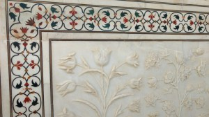 Flowers carved in marble and detail of pietra dura jali inlay