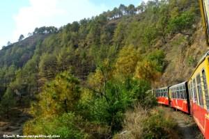 Kalka Shimla toy train chugging along the winding road