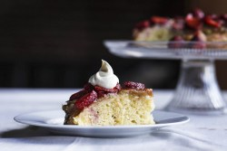 Cast Iron Rhubarb Upside Down Cake with fresh strawberries and real whipped cream