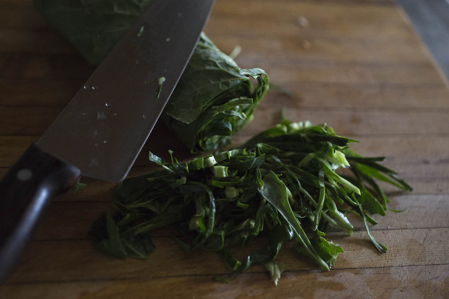 chiffonading the quick collard greens with apples and acv