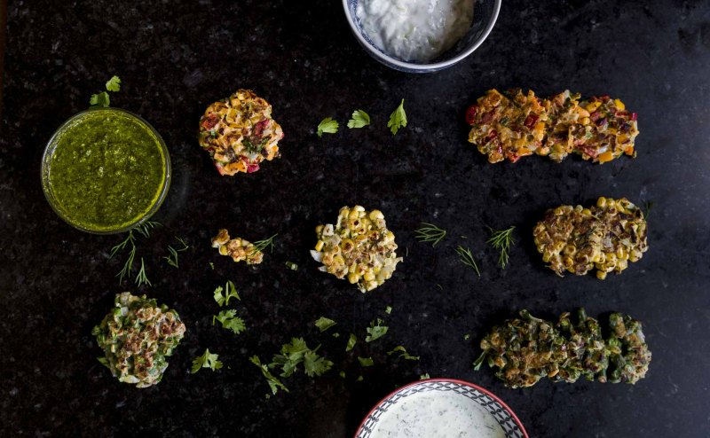 close up of Small batch summer vegetable fritters with sauces