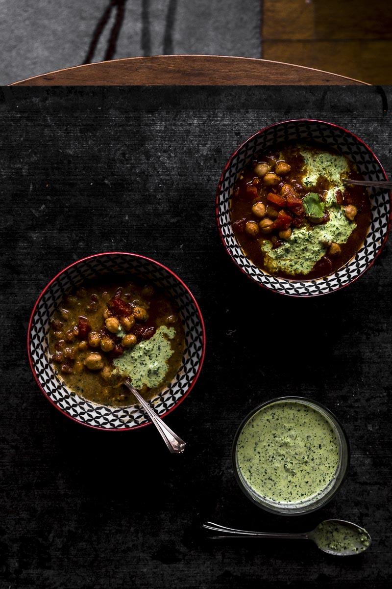 two delicious bowls of Chickpea Chili with spicy cilantro cream
