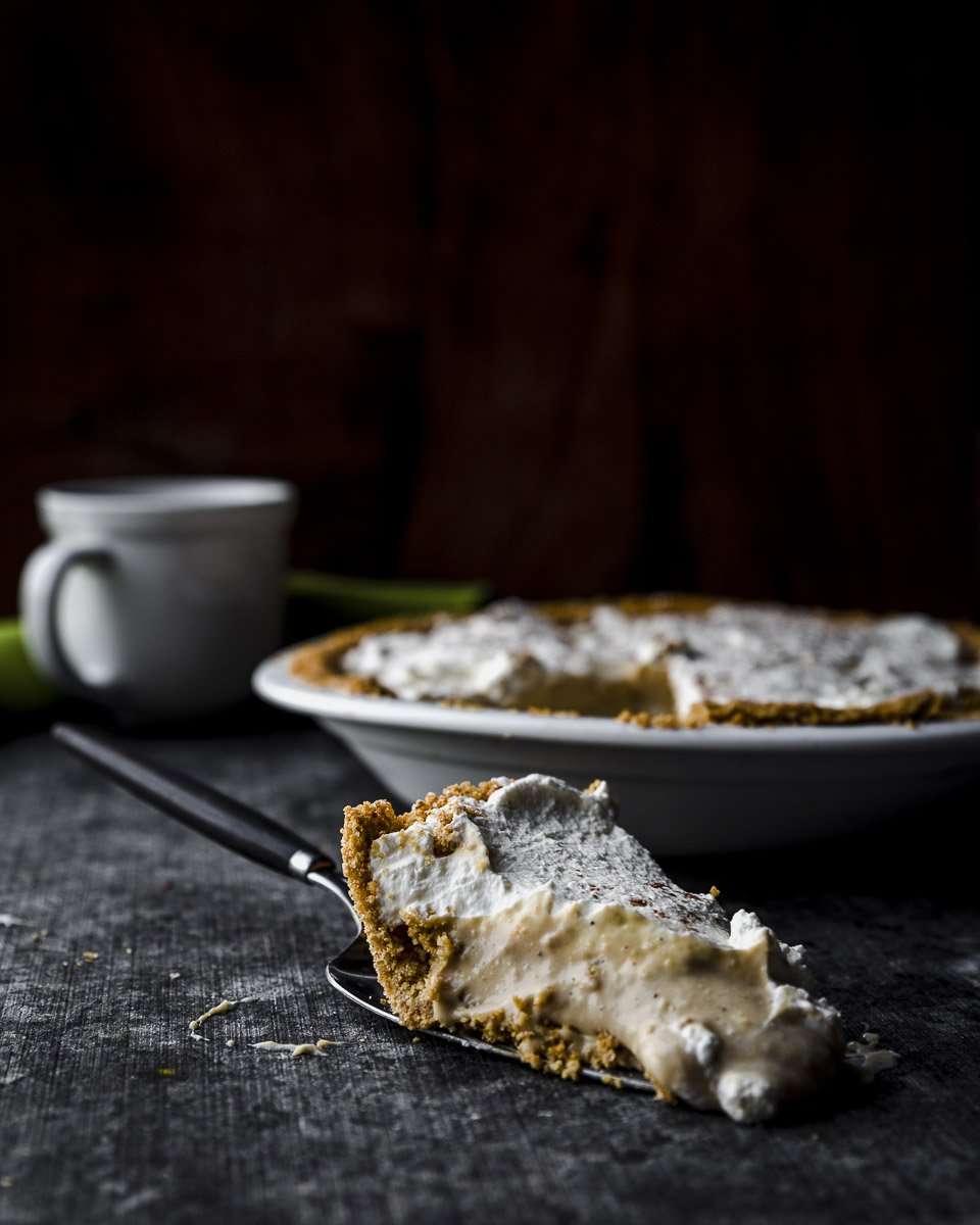 A slice of Irish Cream Pie with graham cracker crust and real whipped cream