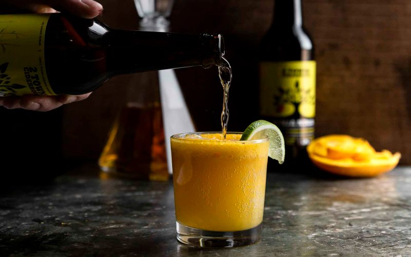 topping the mango rum sorbet with ginja ninja cider
