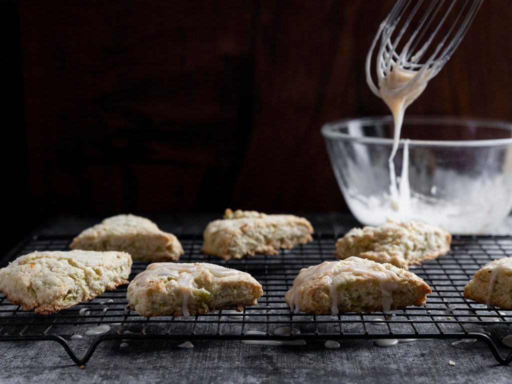 drizzling the rhubarb cream scones with the fresh grapefruit glaze