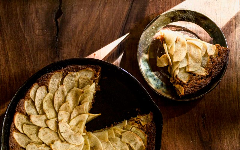 overhead shot of apple spice cake baked in a cast iron pan