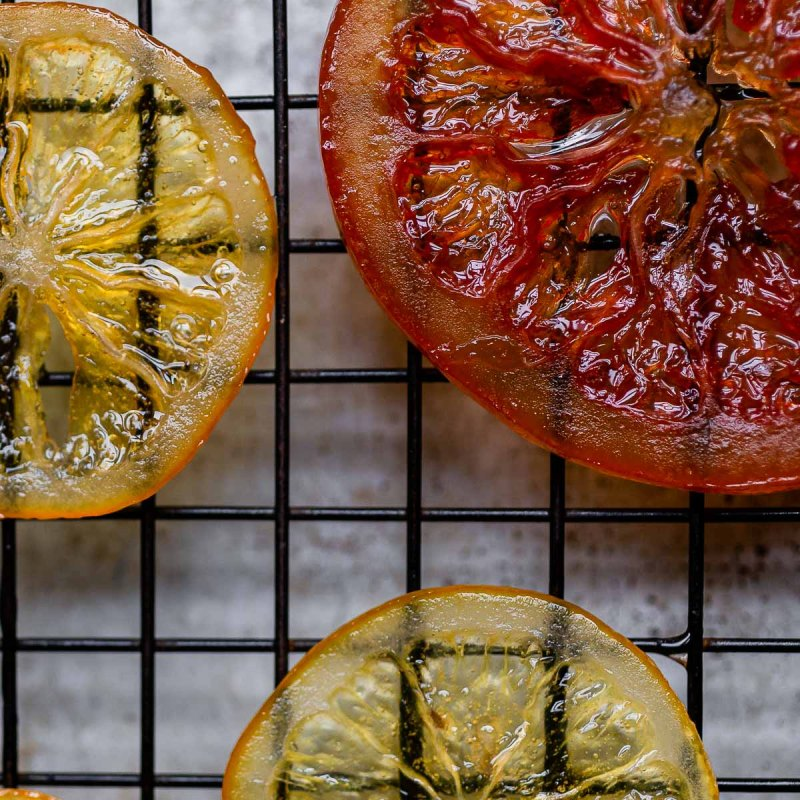 close up of candied meyer lemon and grapefruit slices showing the translucent peel