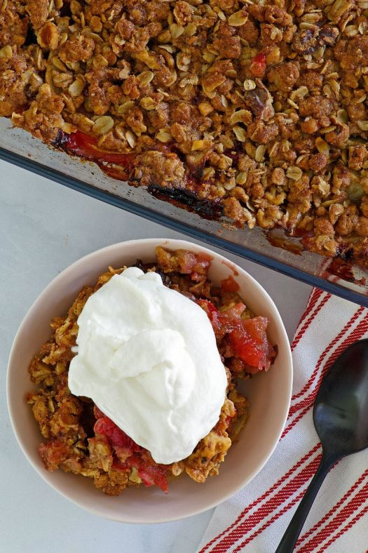 Serving Apple Cranberry Crisp with Maple Whipped Cream