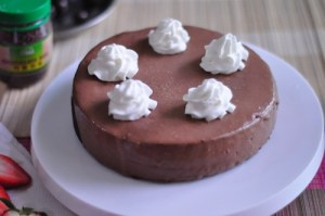 moist dark chocolate cake with whip cream deco