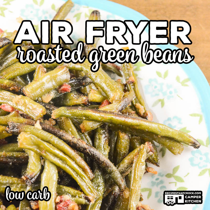 Our Air Fryer Roasted Green Beans are a flavorful, easy low carb recipe you can make in a traditional air fryer or Ninja Foodi.