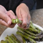 Gently snap off ends of asparagus