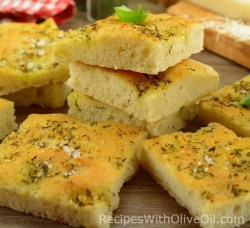 soft crusty focaccia slices with herbs and olive oil