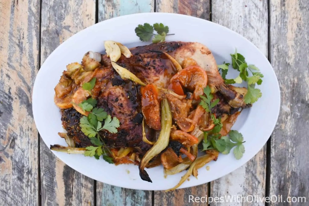 Roasted citrus chicken with olive oil marinade on plate