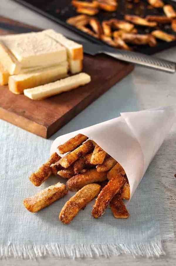 Cinnamon Sugar Bread Crust Treats in a paper cone