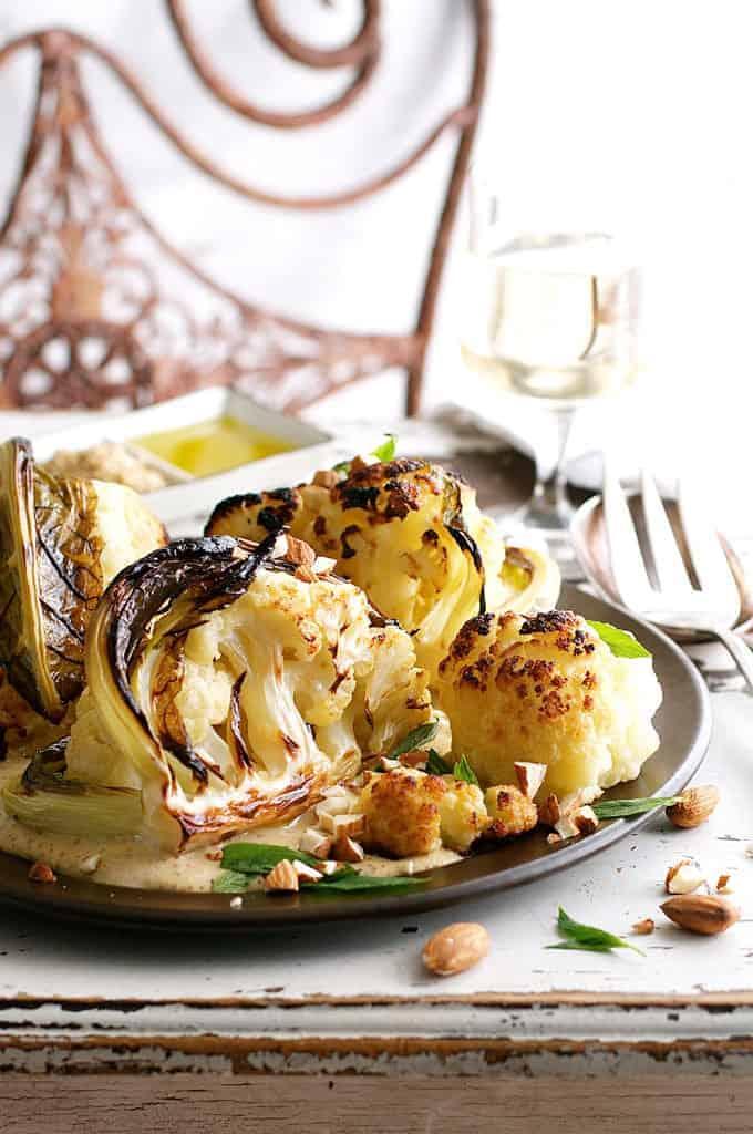 Ester's Roasted Cauliflower with Almond Sauce on dark plate
