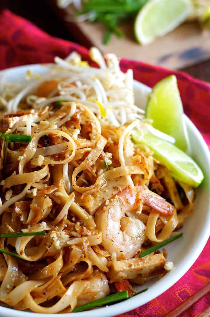 Closeup of Shrimp Pad Thai with lime garnishes