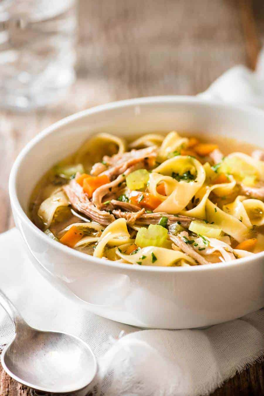 Chicken Vegetable Noodle Soup in a white bowl, ready to be eaten.