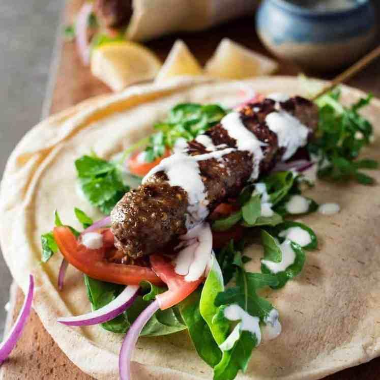 Turkish Lamb Kebab Kofta on pita with vegetables and yoghurt sauce