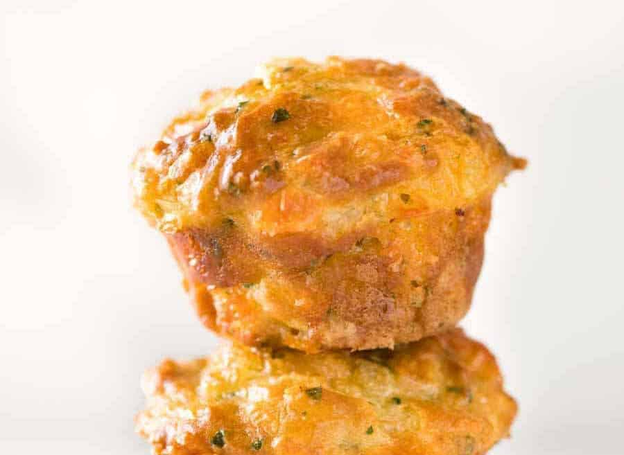 Close up photo of a Savoury Cheese Muffin with a golden dome.