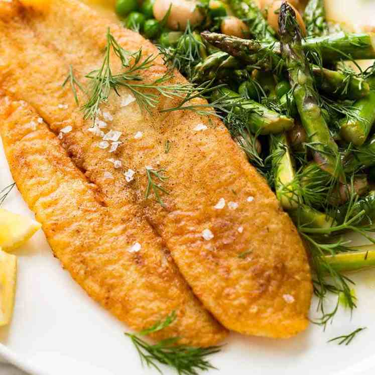 Overhead photo of Crispy Pan Fried Fish with a side of asparagus and beans