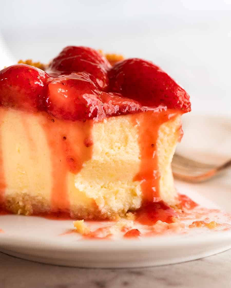 Close up of Strawberry Cheesecake with a bite take out of it
