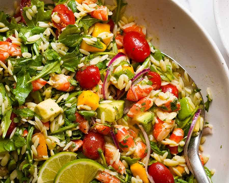 Prawn Mango Avocado Summer Salad with Lime Dressing in a bowl, ready to be served