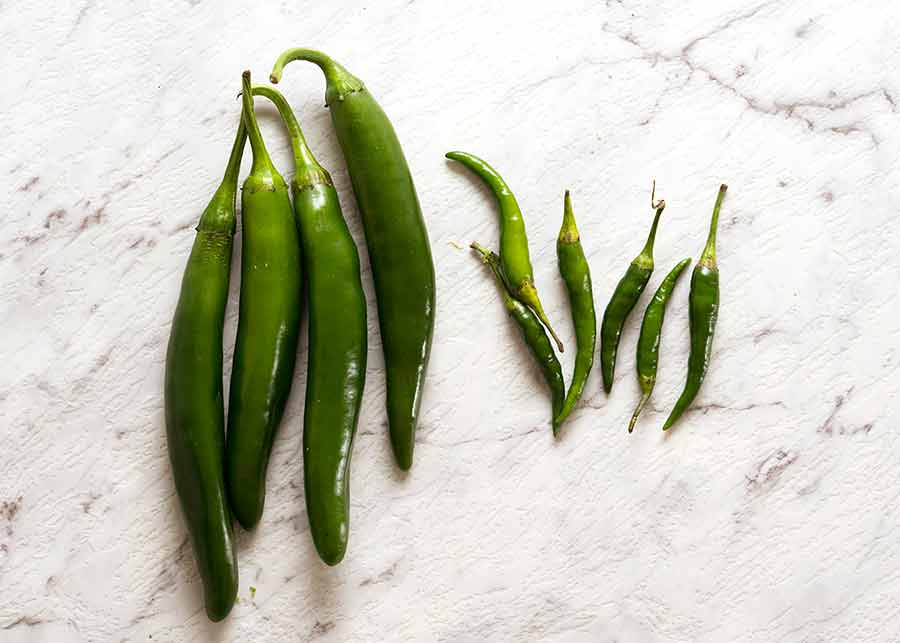 Green cayenne peppers and thai chillies