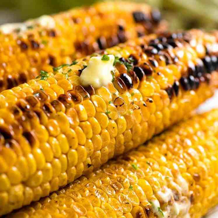 Stack of Grilled Corn with melting butter