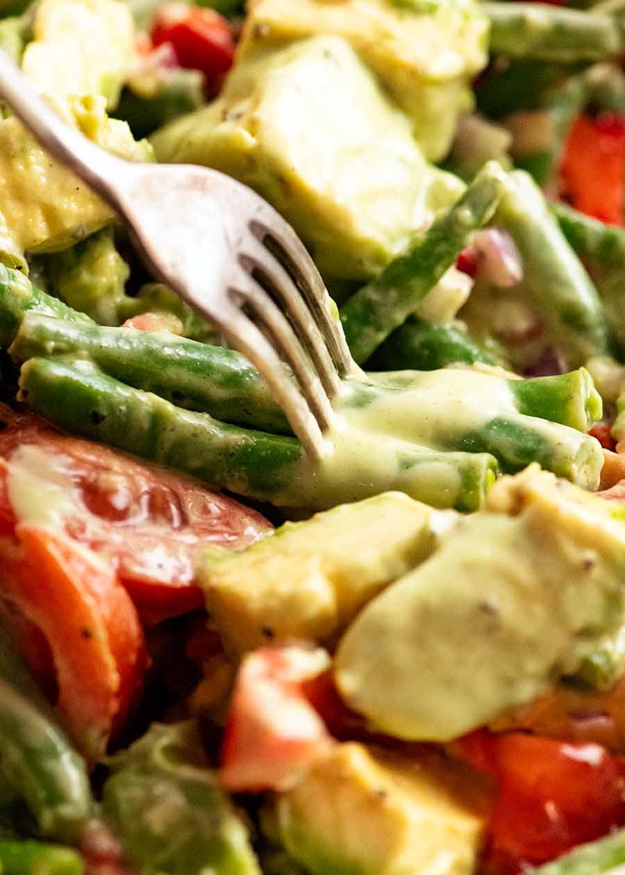 Fork stabbing Green Bean Avocado Salad with Avocado Dressing