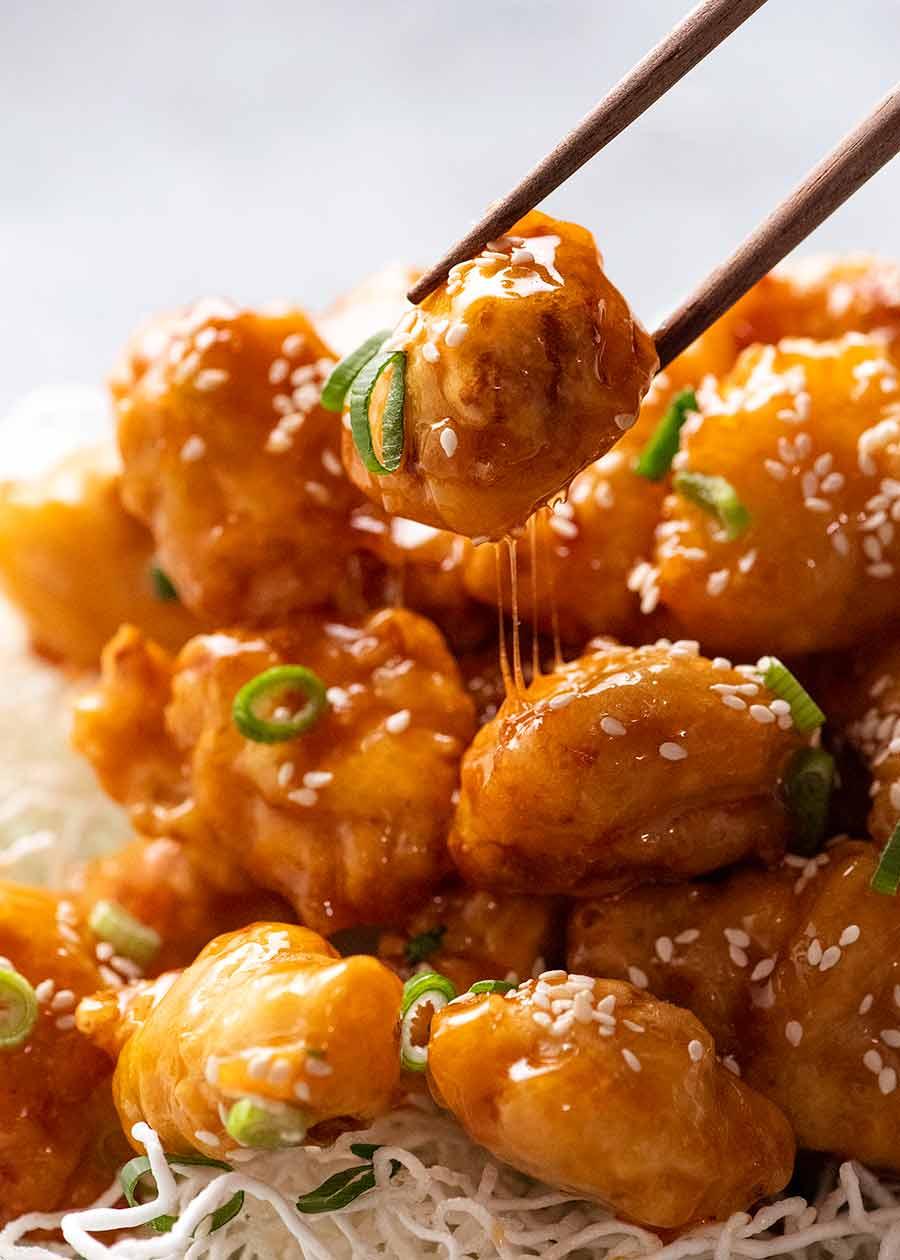 Chopsticks picking up crispy Honey Chicken - built to last!
