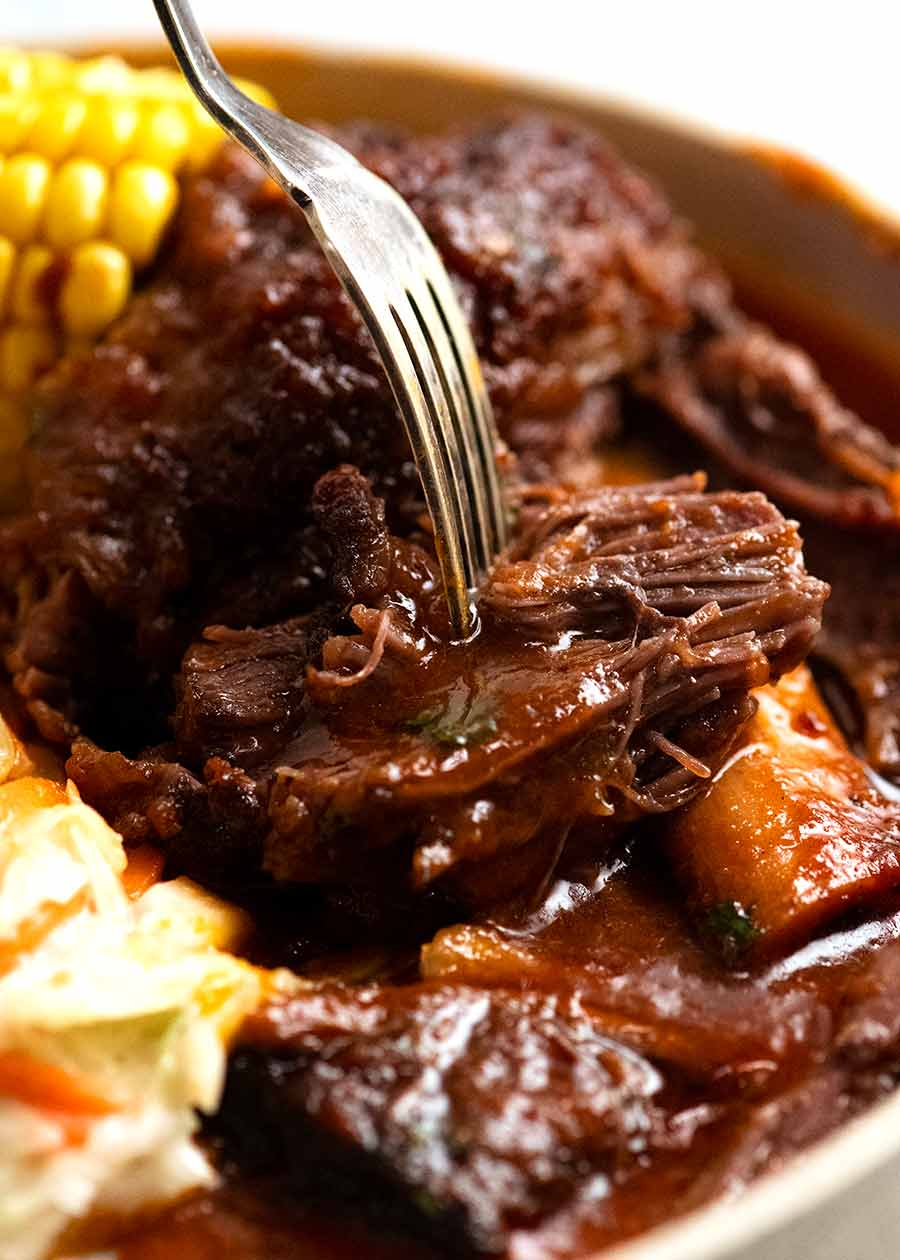 Fork picking up beef short ribs meat