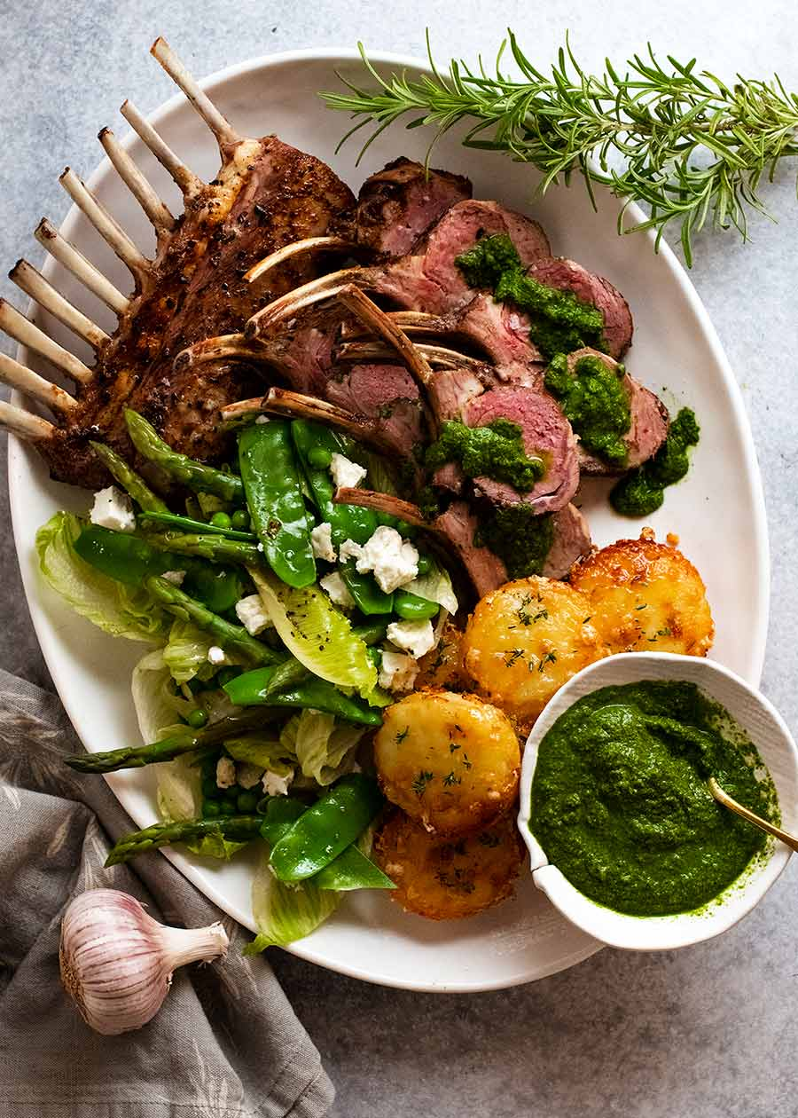 Overhead plating styling of Rack of Lamb on a platter with side salad and mini Potato Gratin