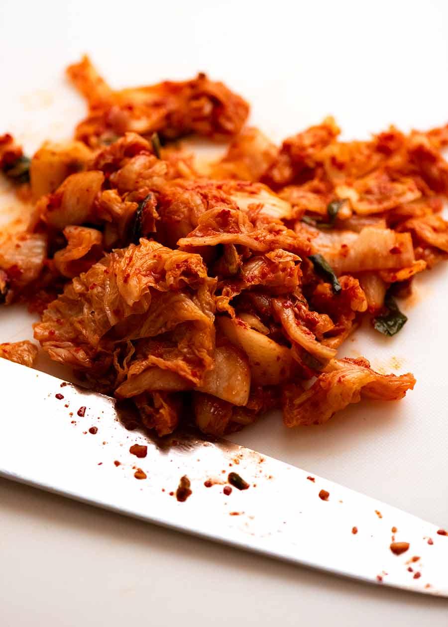 Chopped kimchi on cutting board for Kimchi Fried Rice